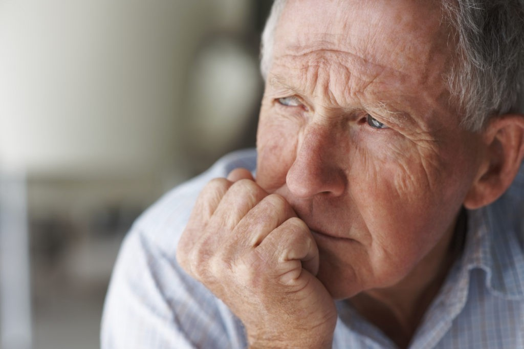 elderly man contemplating
